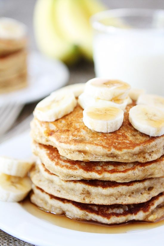 Easy banana pancakes two peas their pod banana pancake stack with maple syrup and sliced bananas ccuart Image collections