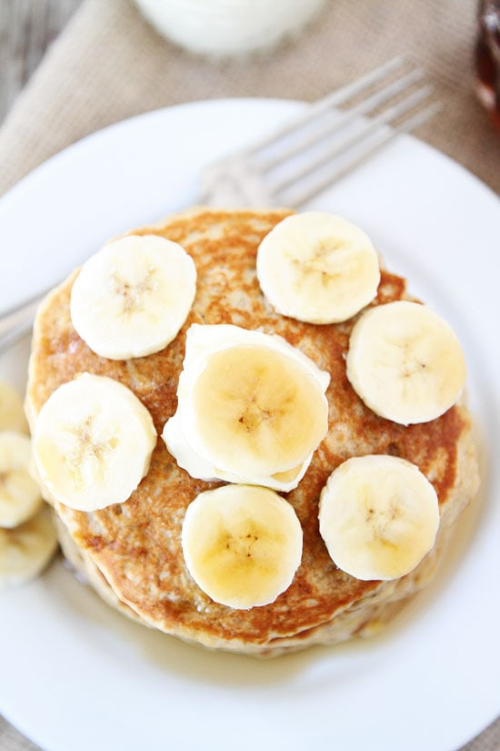 Banana Pancakes on Plate with Sliced Bananas