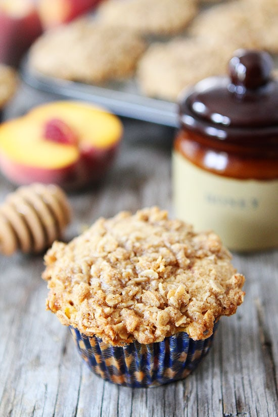 Honey Peach Muffins with Oat Streusel Topping Recipe on twopeasandtheirpod.com These muffins are a MUST make! #muffins #recipe