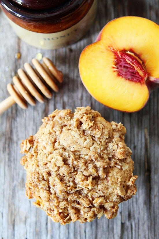 Honey Peach Muffins with Oat Streusel Topping Recipe on twopeasandtheirpod.com Our family loves these muffins and they are easy to make too!