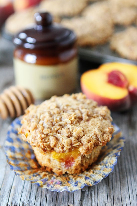 Honey Peach Muffins with Oat Streusel Topping Recipe on twopeasandtheirpod.com These muffins are a MUST make! #breakfast