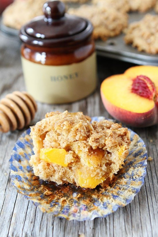 Honey Peach Muffins with Oat Streusel Topping Recipe on twopeasandtheirpod.com Great for breakfast or snack time!