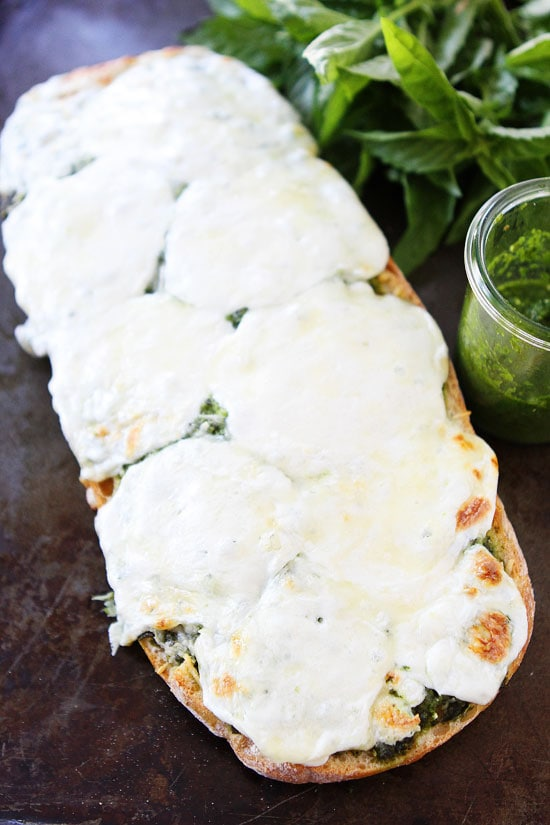 Pesto Cheese Bread Recipe on twopeasandtheirpod.com Love this easy and cheesy bread recipe! #recipe #bread