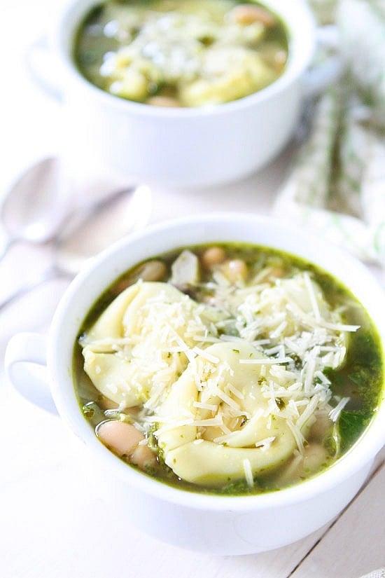 Spinach Artichoke Pesto Tortellini Soup Recipe on twopeasandtheirpod.com