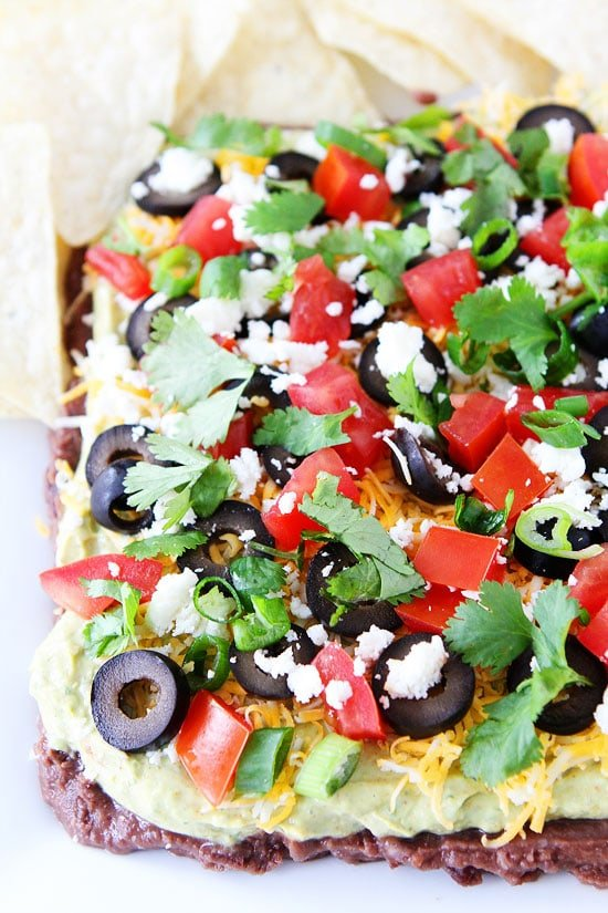 Mexican Layer Dip Recipe on twopeasandtheirpod.com