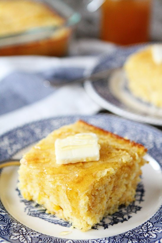 slice of cornbread from scratch with butter and honey