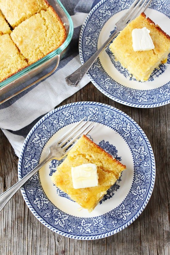 Easy homemade cornbread slices served on plates with butter and honey