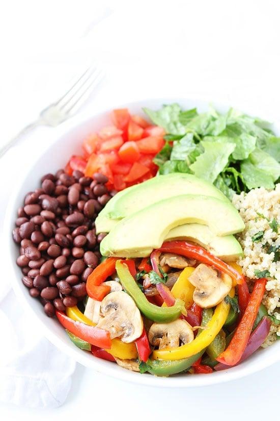 Vegetarian Fajita Quinoa Bowls with black beans, tomatoes and fajita seasoned veggies!