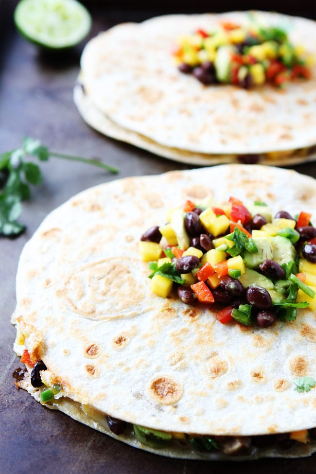 Mango Black Bean Quesadillas made with flour tortillas. A quick an easy dinner the entire family will love!