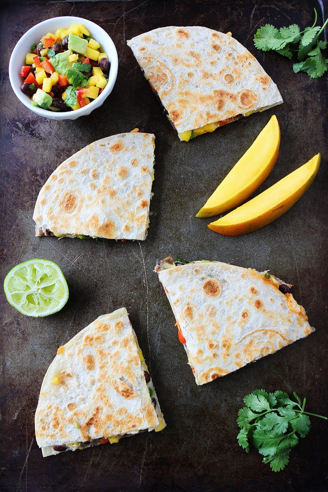 Mango Black Bean Quesadillas made with flour tortillas. A quick an easy meal kids and adults love!