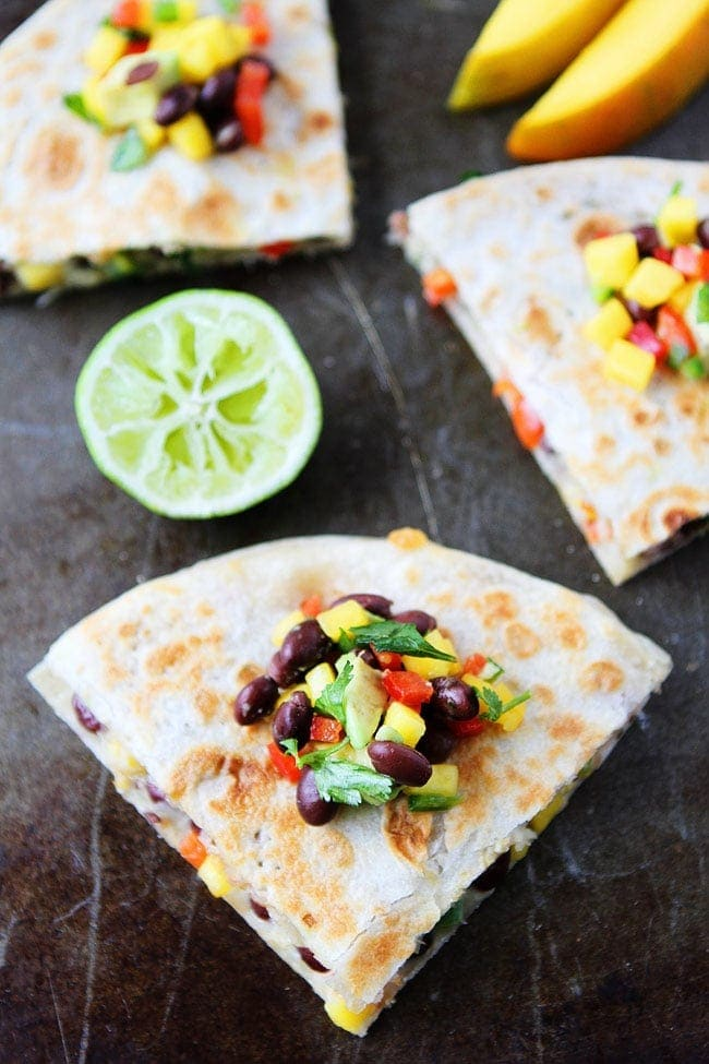 Mango Black Bean Quesadillas with avocado, red pepper, cilantro, onion, and jalapeño make a quick and easy meal that kids and adults love!