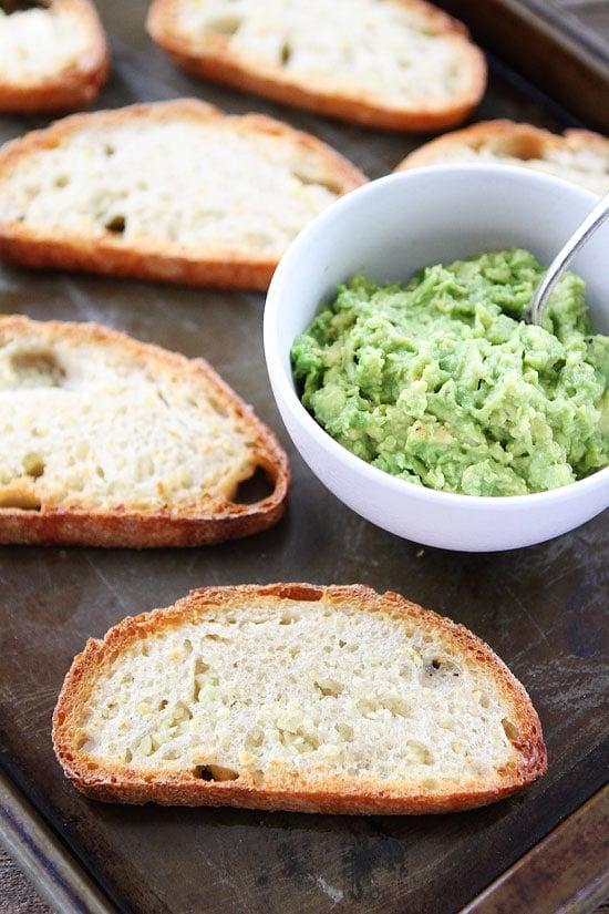 Spooning avocado mash for Garlic Avocado Toast Recipe