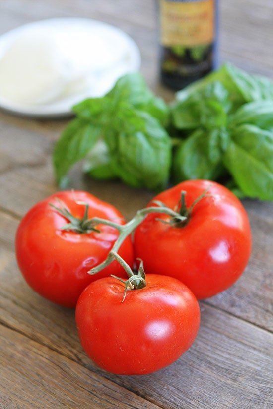 Fresh mozzarella, tomatoes and basil for Caprese Sandwich