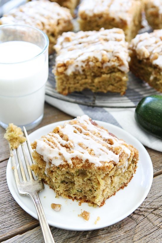 Brown Butter Zucchini Coffee Cake on plate with glass of milk