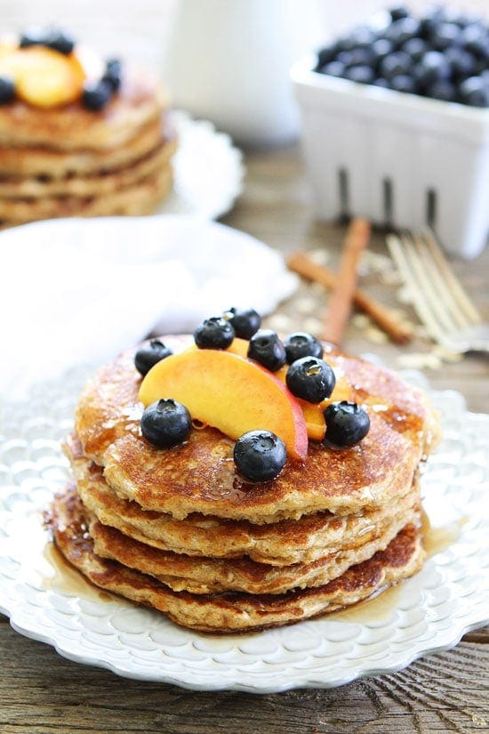 Cinnamon Oatmeal Pancakes with fruit on top