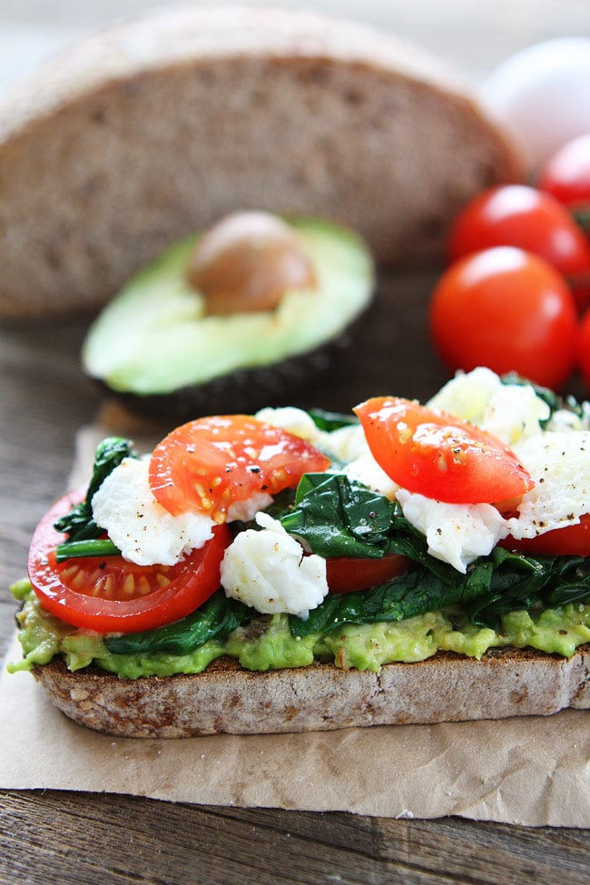 Avocado Toast with Eggs, Spinach, and Tomatoes Recipe