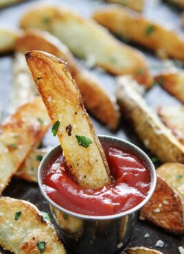 Parmesan potato wedges with garlic dipped in ketchup