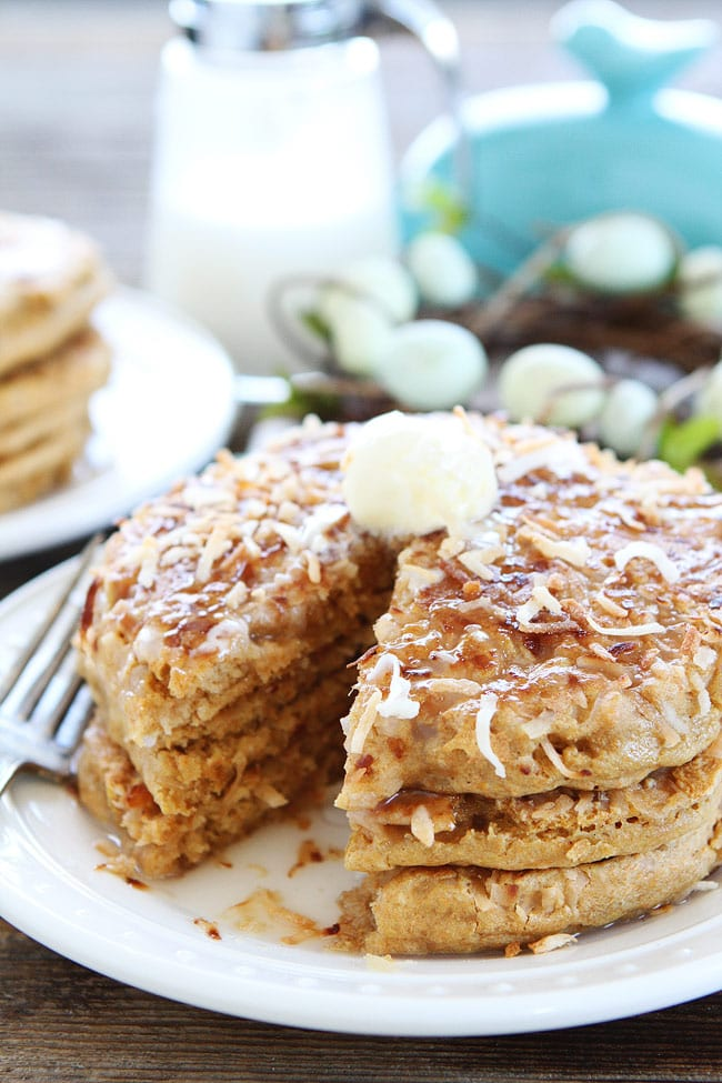 Plate of stacked Toasted Coconut Pancakes with butter