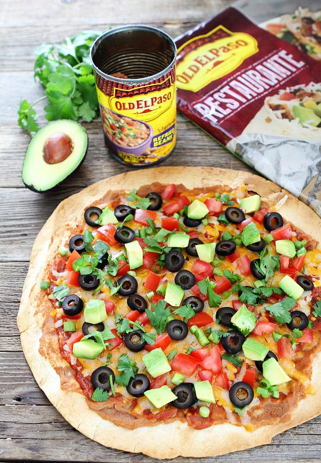 Mexican-Inspired Tortilla Pizza with Enchilada sauce and veggies
