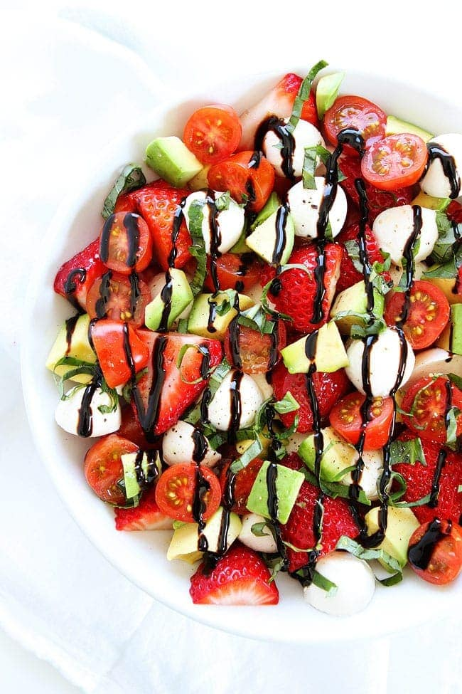 Avocado Caprese Salad with Strawberries in large bowl