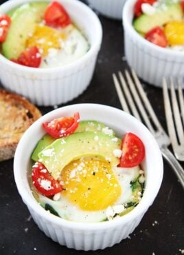 Baked eggs with Spinach and Avocado in ramekins