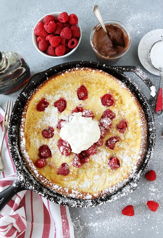 Dutch Baby Pancake in skillet with ingredients and toppings