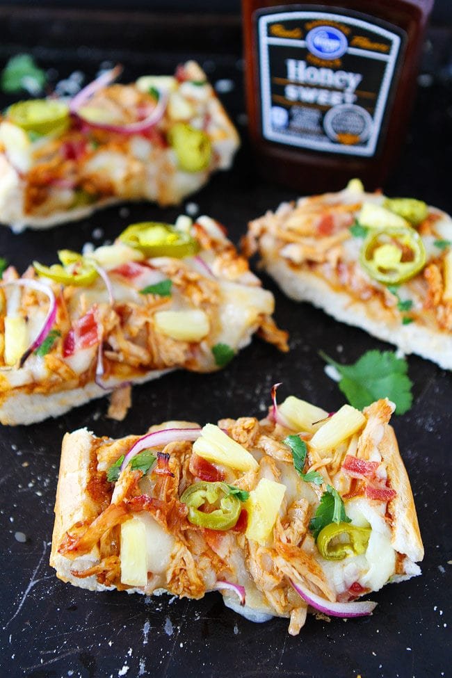 BBQ Chicken French Bread Pizza made with store-bought French bread and topped with BBQ sauce, chicken, bacon, mozzarella cheese, pineapple, jalapeño, and cilantro. This easy pizza is a favorite weeknight dinner.