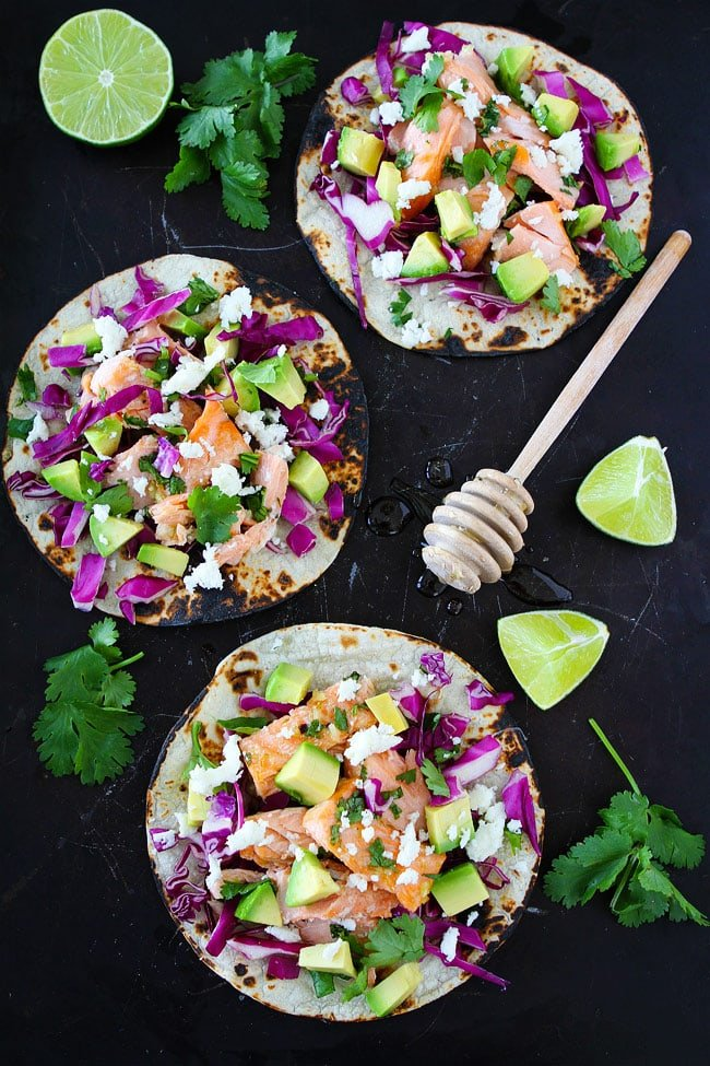 Salmon tacos with red cabbage avocado and cheese