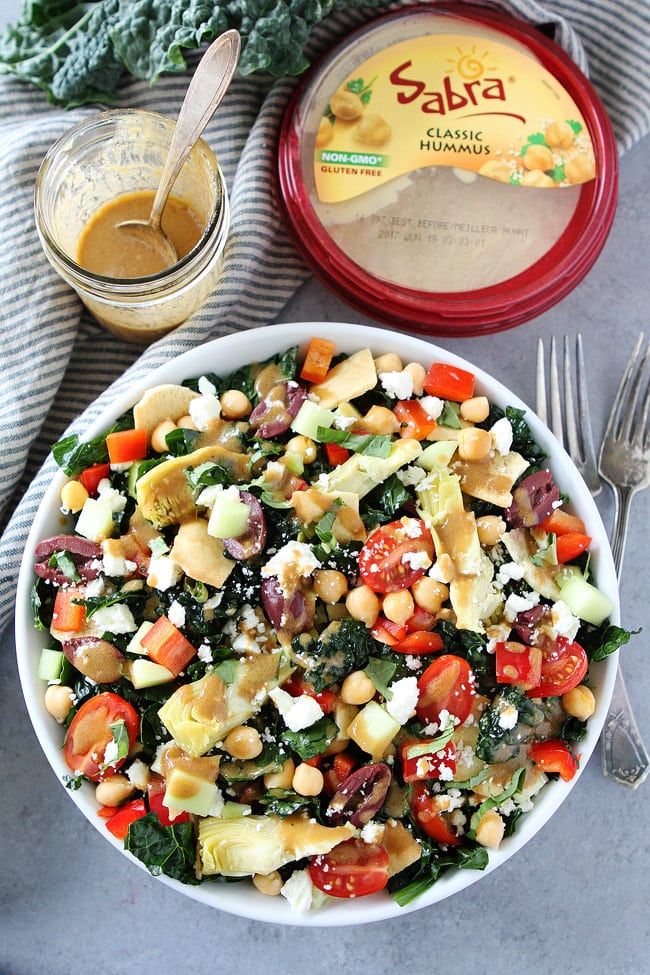 Mediterranean Kale Salad with a simple hummus balsamic dressing makes a great side dish or main dish.