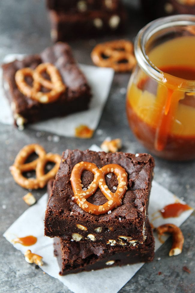 Salted Caramel Pretzel Brownies are fudgy, gooey brownies with salty pretzel pieces and a layer of salted caramel sauce. Everyone loves these sweet and salty brownies.