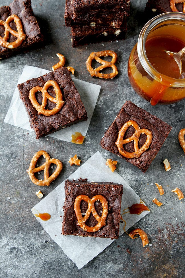 Salted Caramel Pretzel Brownies are fudgy, gooey brownies with pretzel pieces and a layer of salted caramel sauce. These brownies are a great potluck and party dessert!