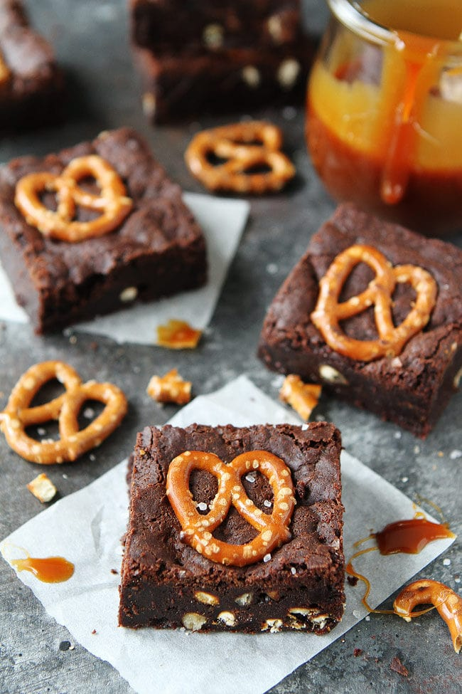 Salted Caramel Pretzel Brownies are fudgy, gooey brownies with pretzel pieces and a layer of salted caramel sauce. You will love these sweet and salty brownies.