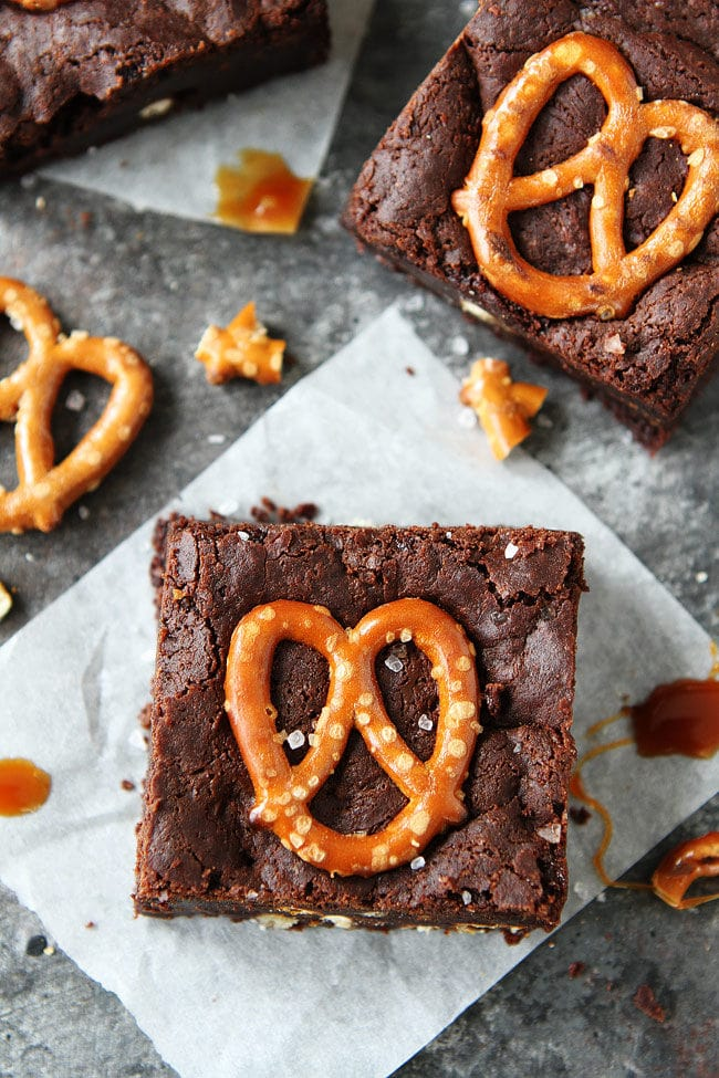 How to make the BEST Salted Caramel Pretzel Brownies. These brownies are fudgy, gooey with salty pretzels and caramel sauce.