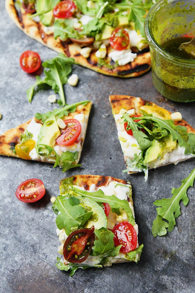 Easy Grilled Flatbread Pizza with burrata, tomatoes, avocado, and basil vinaigrette. A quick and easy summer meal.