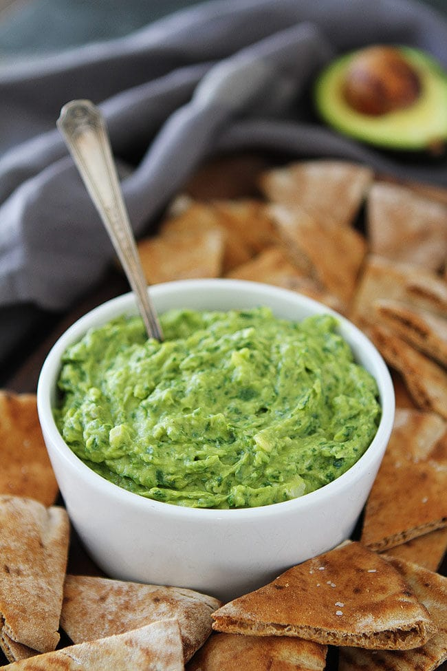 Avocado, Spinach, and Artichoke Dip is the perfect appetizer for parties or a great easy every day snack! It is great served with pita chips, crackers, or cut up vegetables.