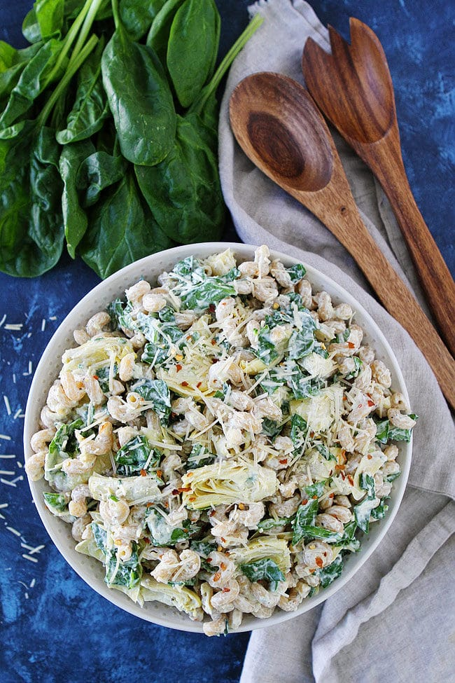 Spinach Artichoke Pasta Salad is a family favorite recipe! The perfect side dish for potlucks and parties!