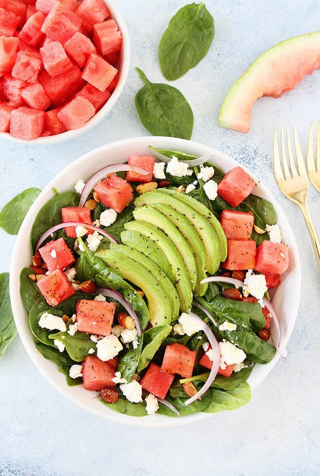 Watermelon Avocado Spinach Salad with feta, almonds, red onion, and poppy seed dressing is the best summer salad!
