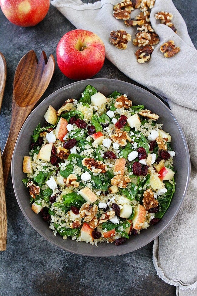 Apple Walnut Quinoa Salad with spinach, dried cranberries, goat cheese, and a simple maple mustard dressing is the perfect salad for fall. #salad #glutenfree
