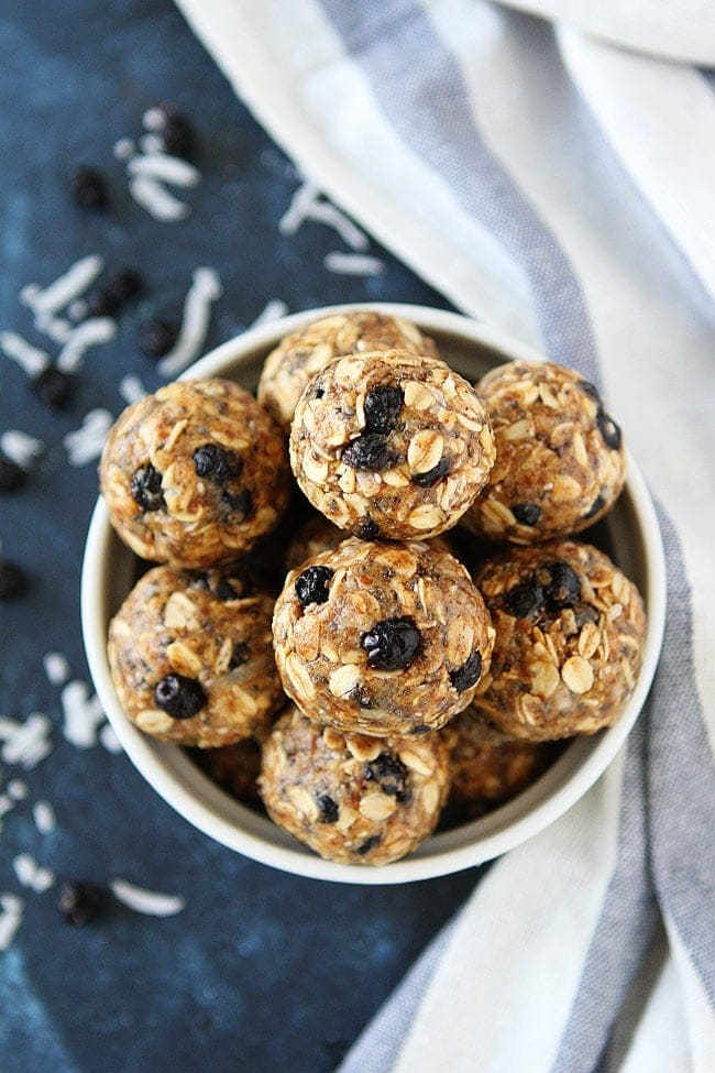 Blueberry Coconut Energy Bites are a healthy on the go snack that only take 10 minutes to make! Kids and adults love these little no-bake energy balls! #energybites #glutenfree #vegetarian #snack #healthysnack