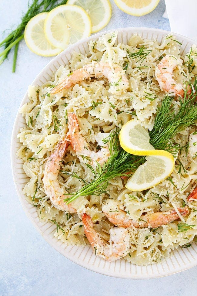 Easy Shrimp Pasta Salad is the perfect dish to make for parties, potlucks or weeknight meals. It fresh, delicious, and only takes 20 minutes to make.