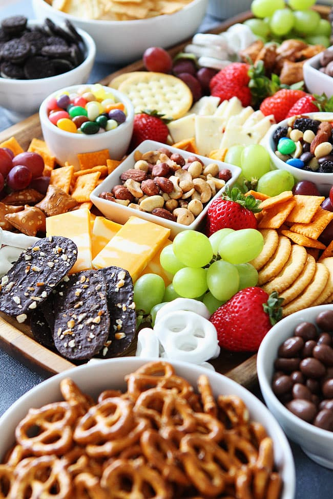 Sweet and Salty Snack Board-the perfect party food for easy entertaining. You will love the mix of sweet and salty snacks for game day or any party!
