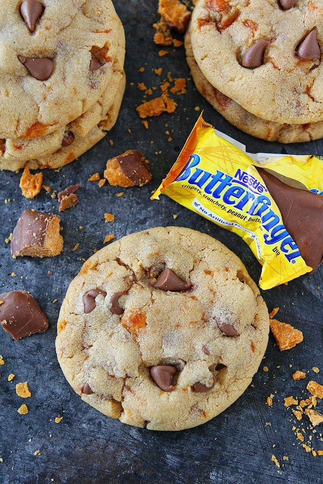 Peanut Butter Butterfinger Cookies-soft peanut butter cookies with Butterfinger candy bars and milk chocolate chips! Use your leftover Halloween candy to make these delicious cookies!