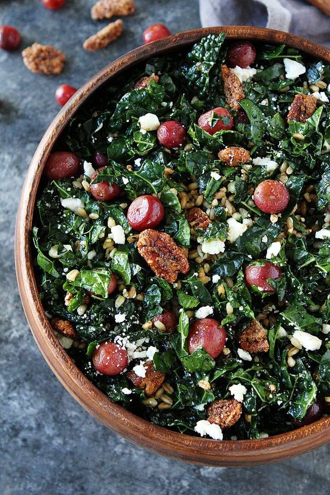 This easy kale salad with roasted grapes and farro goes great with any meal or can be a meal! You will love the flavors! #salad #vegetarian #farro #kale #kalesalad