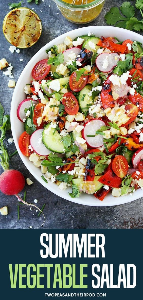 This simple summer vegetable salad is full of flavor and a great side dish to any meal. Enjoy this easy summer vegetable salad all summer long! It is great for lunch, dinner, or for summer BBQ's! Visit twopeasandtheirpod.com for more simple, fresh, and family friendly meals. #salad #summer #vegetables #glutenfree #vegetarian #healthyrecipe #healthy
