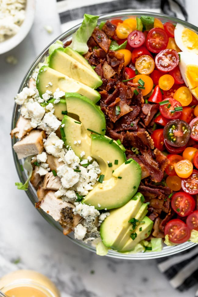 Easy Cobb Salad with chicken, bacon, avocado, cheese, tomatoes, and chives