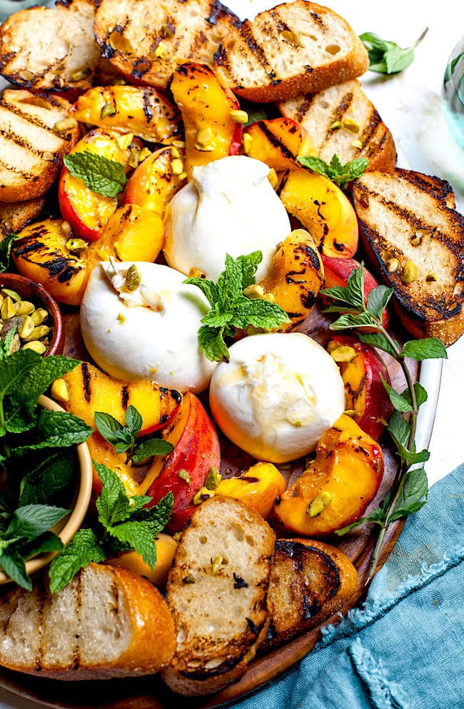 Grilled Peaches with Burrata, Honey, Pistachios, and Mint