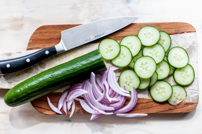 Cucumber Salad ingredients on cutting board