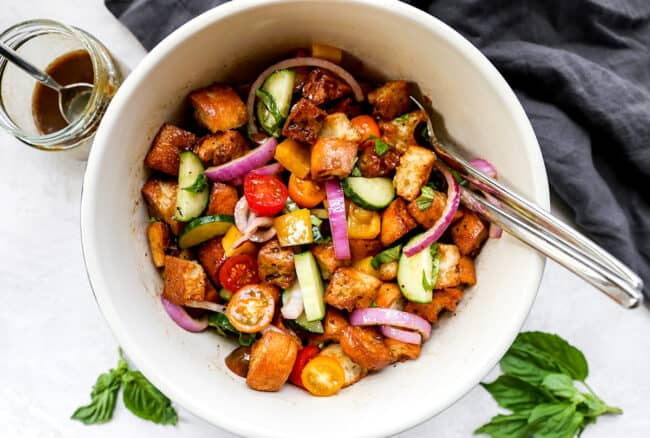 Tossing Panzanella Salad in a bowl