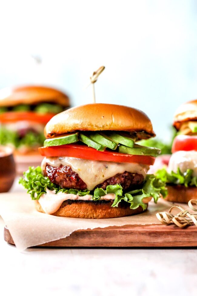 Chipotle Burgers with cheese, avocado, tomato, and lettuce