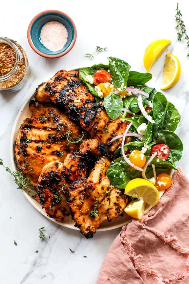 Honey mustard chicken on plate with salad